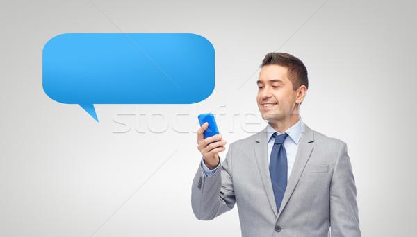 happy businessman texting message on smartphone Stock photo © dolgachov