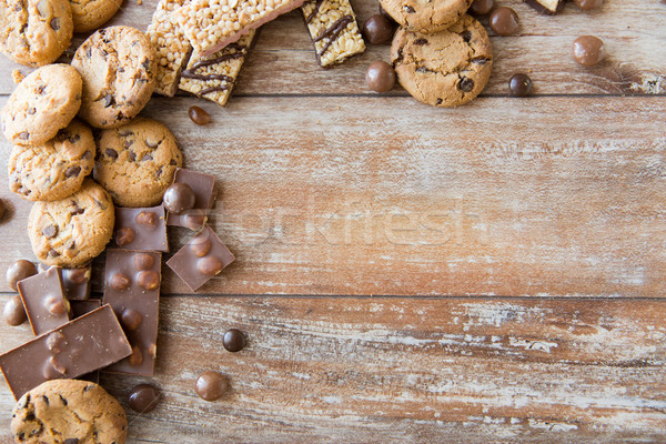 close up of candies, chocolate, muesli and cookies Stock photo © dolgachov