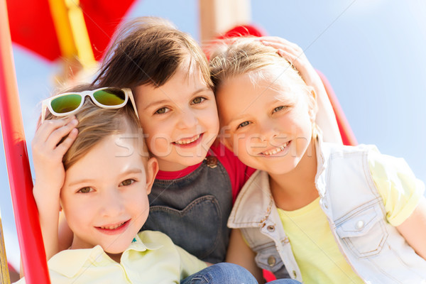 group of happy kids on children playground Stock photo © dolgachov