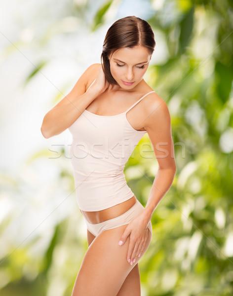 Nő pamut alsónemű megérint lábak öko Stock fotó © dolgachov
