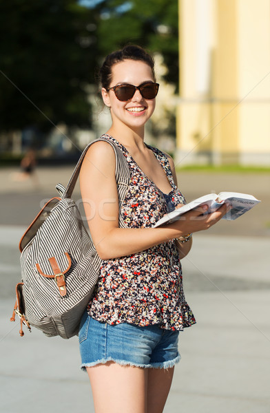 happy teenage girl with guidebook and backpack Stock photo © dolgachov