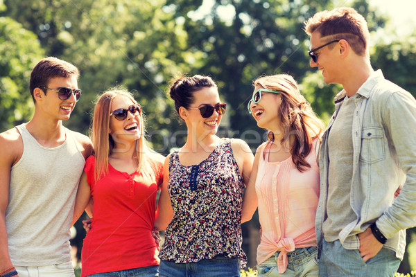 group of smiling friends outdoors Stock photo © dolgachov