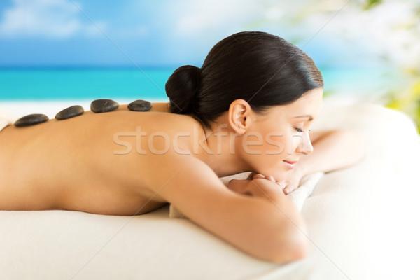 Mulher estância termal quente pedras quadro salão Foto stock © dolgachov