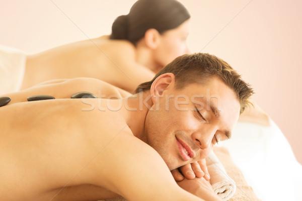 couple in spa with hot stones Stock photo © dolgachov