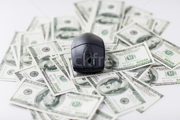 close up of computer mouse and dollar cash money Stock photo © dolgachov