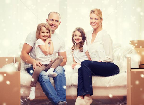 Gülen ebeveyn iki yeni ev aile Stok fotoğraf © dolgachov