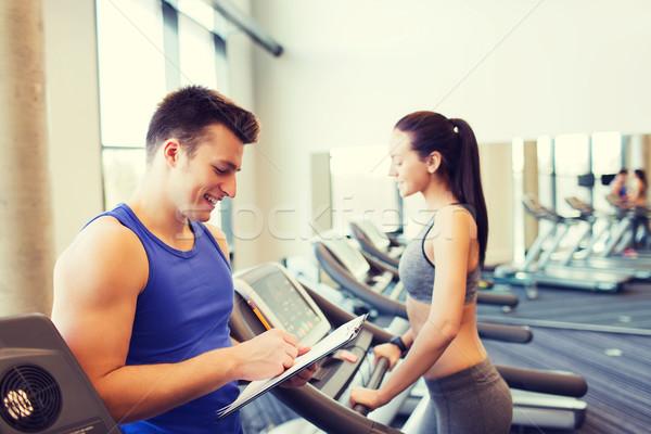 Boldog nő edző futópad tornaterem sport Stock fotó © dolgachov