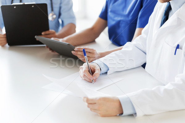 Stock photo: close up of happy doctors at seminar or hospital