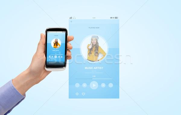 Közelkép kéz okostelefon zenelejátszó emberek technológia Stock fotó © dolgachov