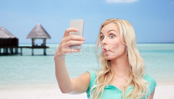 Stockfoto: Grappig · jonge · vrouw · smartphone · uitdrukkingen · technologie