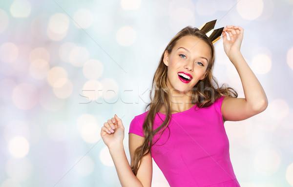 Boldog fiatal nő tinilány rózsaszín ruha emberek Stock fotó © dolgachov