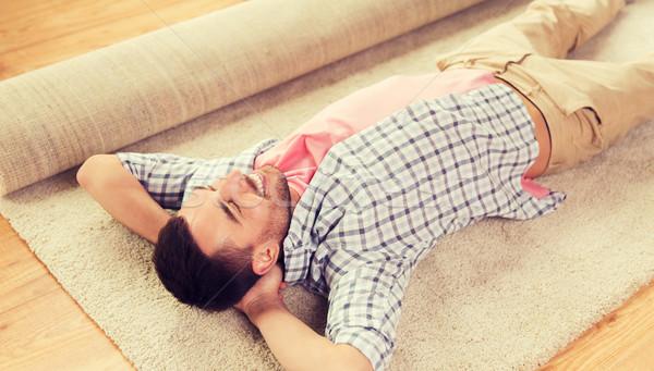 happy man lying carpet or rug at home Stock photo © dolgachov