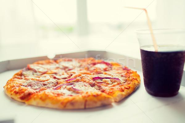 Közelkép pizza kóla asztal gyorsételek olasz Stock fotó © dolgachov