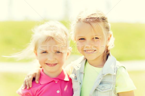 happy little girls hugging outdoors at summer Stock photo © dolgachov