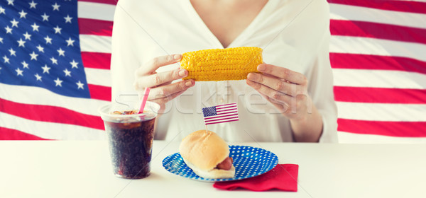 woman hands holding corn with hot dog and cola Stock photo © dolgachov