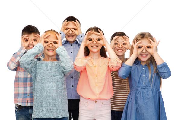 happy children making faces and having fun Stock photo © dolgachov