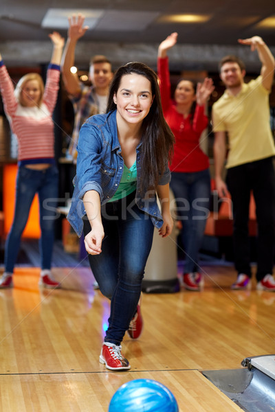 Boldog fiatal nő dob labda bowling klub Stock fotó © dolgachov
