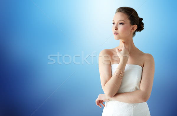 beautiful asian woman with golden bracelet Stock photo © dolgachov