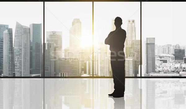 Silhouet zakenman kantoor zakenlieden zakenman venster Stockfoto © dolgachov