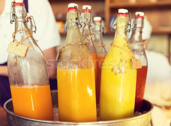 Garrafas suco gelo balde mercado bebidas Foto stock © dolgachov