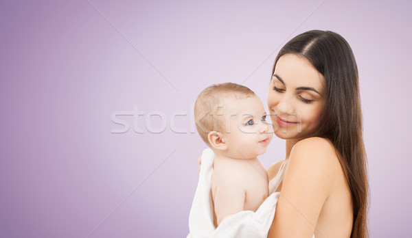 Stock photo: happy mother holding adorable baby