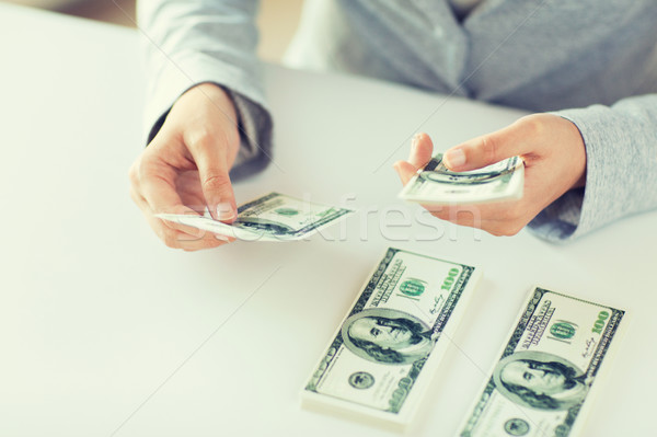close up of woman hands counting us dollar money Stock photo © dolgachov