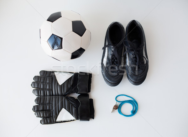 close up of soccer ball, gloves, whistle and boots Stock photo © dolgachov