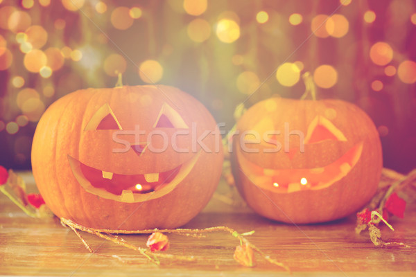 Stock photo: close up of carved halloween pumpkins on table