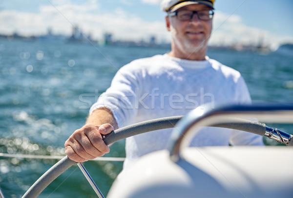 Supérieurs homme bateau yacht voile mer Photo stock © dolgachov