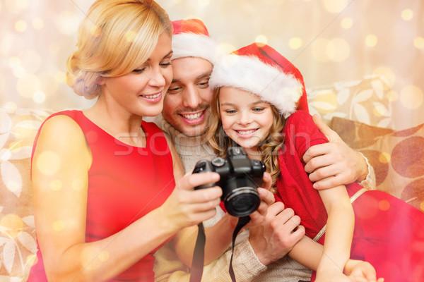 Familie helper hoeden naar christmas Stockfoto © dolgachov