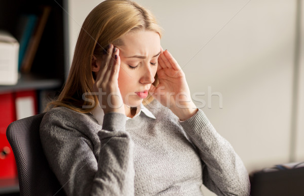 close up of businesswoman with headache at office Stock photo © dolgachov