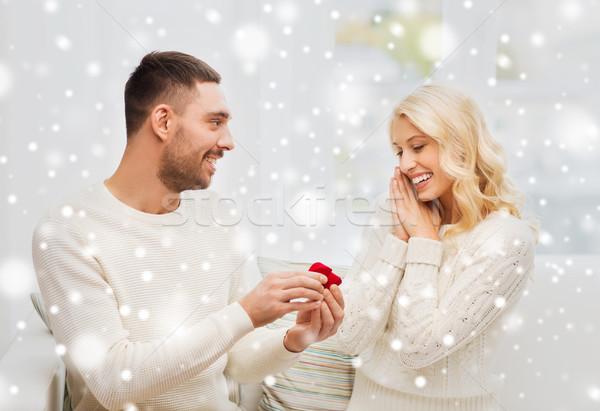 Férfi nő eljegyzési gyűrű karácsony szeretet pár Stock fotó © dolgachov