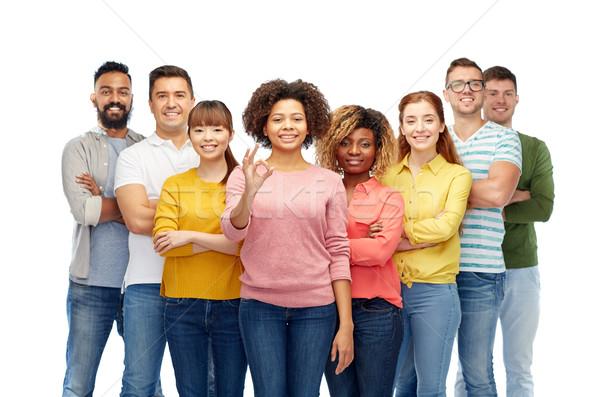 Internacional grupo feliz a la gente diversidad Foto stock © dolgachov