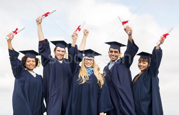 Stock fotó: Boldog · diákok · integet · oktatás · érettségi · emberek