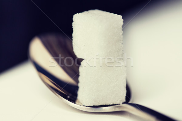 close up of white sugar cubes on teaspoon Stock photo © dolgachov