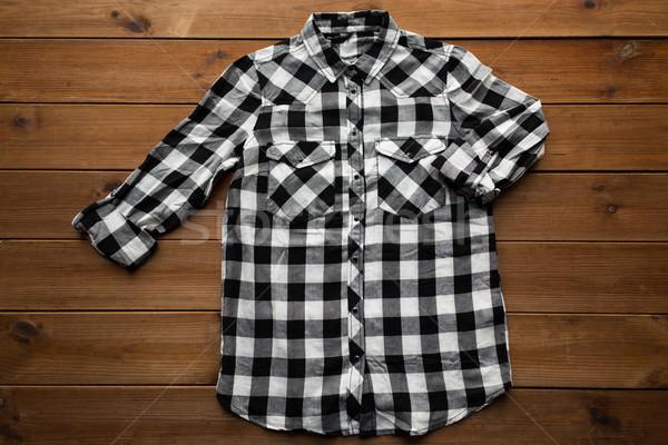 checkered shirt on wooden background Stock photo © dolgachov