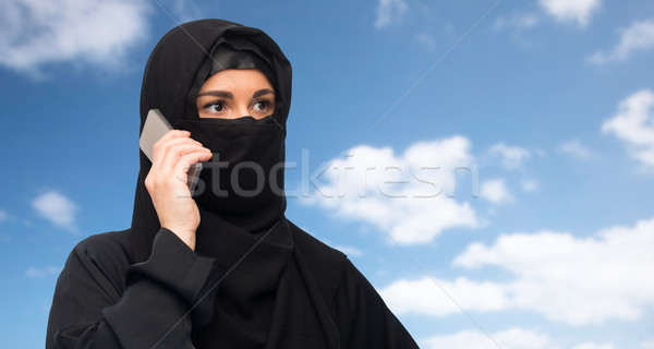 muslim woman in hijab over white background Stock photo © dolgachov