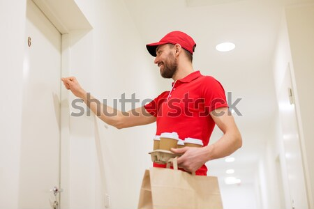 delivery man with pizza boxes knocking on door Stock photo © dolgachov