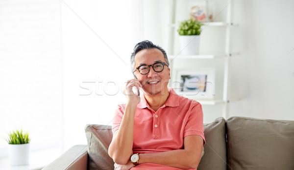 快樂 男子 調用 智能手機 家 技術 商業照片 © dolgachov