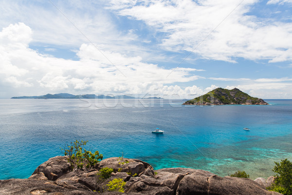 island and boats in indian ocean on seychelles Stock photo © dolgachov