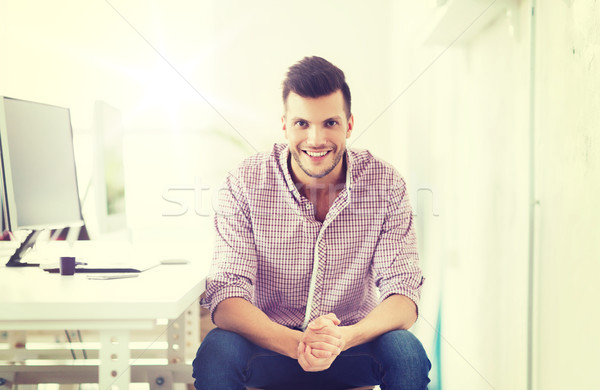 happy creative man with computer at office Stock photo © dolgachov