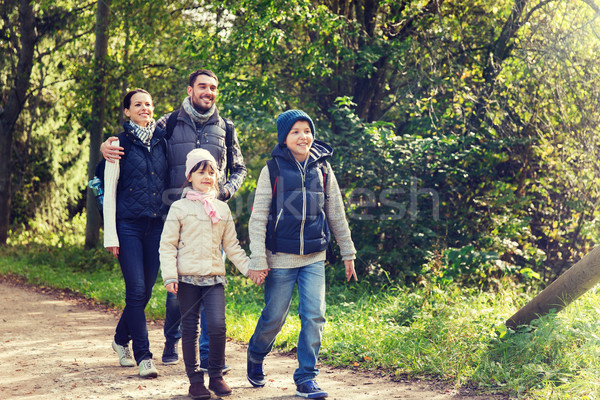 happy family with backpacks hiking in woods Stock photo © dolgachov
