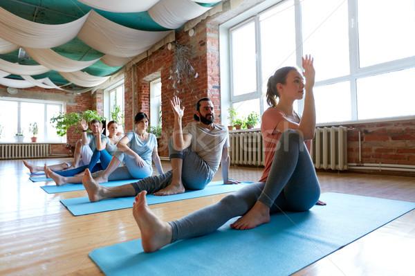 group of people doing yoga at studio Stock photo © dolgachov