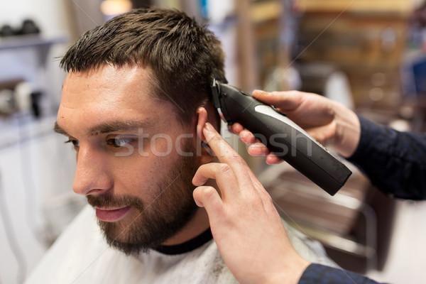 Adam berber eller saç Stok fotoğraf © dolgachov