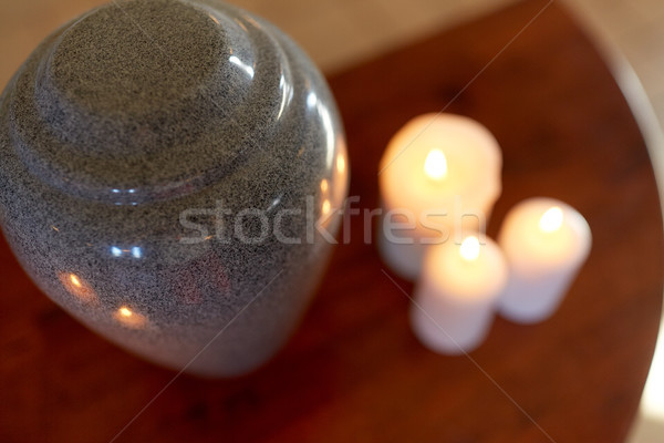 cremation urn and candles burning on table Stock photo © dolgachov