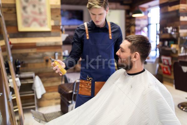 Fodrász mutat haj spray férfi vásárló Stock fotó © dolgachov