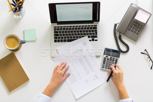 hands with calculator and papers at office table Stock photo © dolgachov