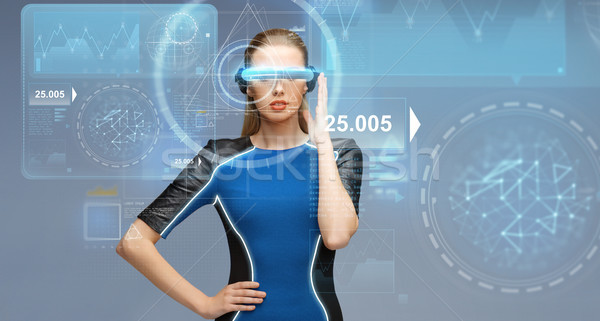woman in virtual reality 3d glasses with charts Stock photo © dolgachov