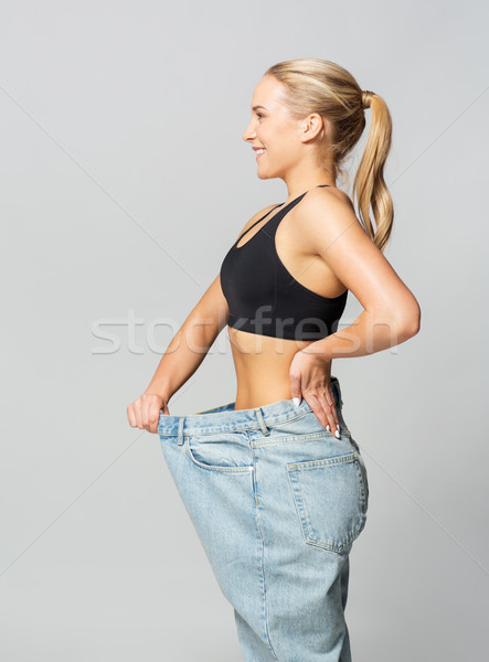 Jeunes mince femme pants fitness Photo stock © dolgachov