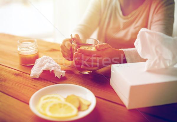 ill woman drinking tea with lemon and honey Stock photo © dolgachov